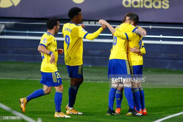 Alberto Perea of Cadiz CF celebrates with team mates Alex Fernandez and Anthony Lozano after scoring their side's first goal during the La Liga...
