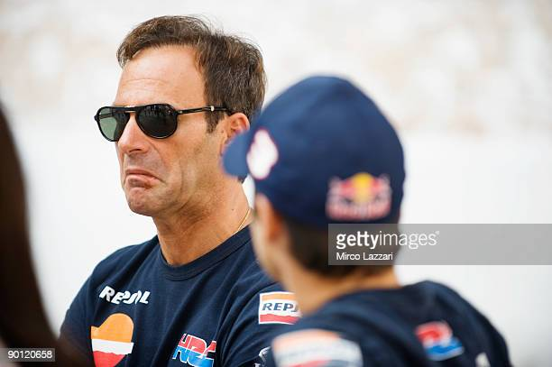Alberto Puig of Spain and Repsol Honda Team looks on during the Kick Start Celebration in Red Bull Energy Station in downtown Indianpolis on August...