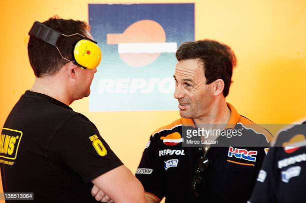 Alberto Puig of Spain manager of Dani Pedrosa of Spain and Repsol Honda Team speaks in the garage during the first day of MotoGP testing at Sepang...