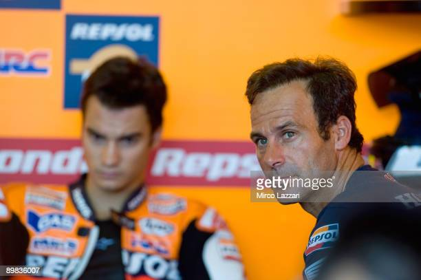 Alberto Puig of Spains look on near Dani Pedrosa of Spain and Repsol Honda Team in box during the monday MotoGP test in Brno Circuit on August 17...