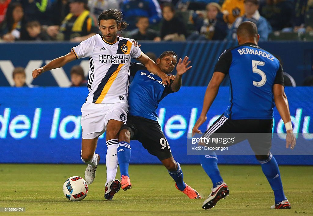 Alberto Quintero #91 and Victor Bernardez #5 of the San Jose Earthquakes defend against Baggio Husidic #6 of the Los Angeles Galaxy during the first half of their MLS match at StubHub Center on March 19, 2016 in Carson, California.