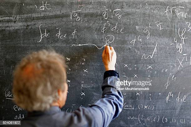 Alberto Ramos Theoretical Physics Fellow and visitor Antonio GonzalezArroyo from the Universidad Autonoma de Madrid talk and make notes on the...
