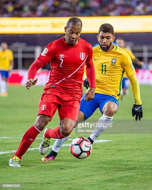 Alberto Rodríguez of Peru controls the ball as Gabriel of Brazil defends during a group B match between Brazil and Peru at Gillette Stadium as part...