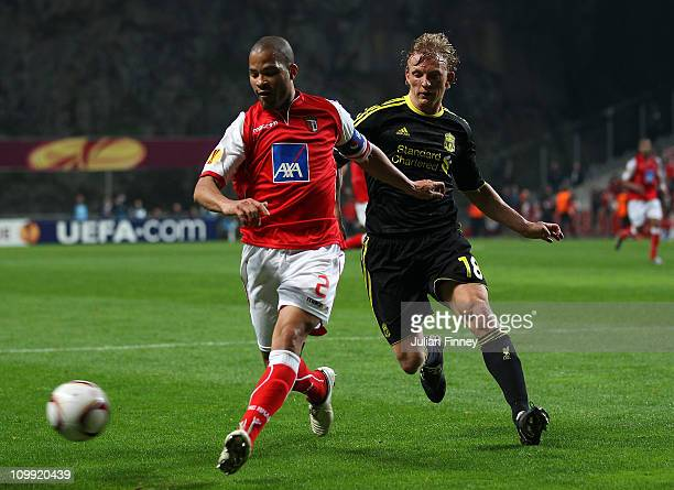 Alberto Rodriguez of Braga battles with Dirk Kuyt of Liverpool during the UEFA Europa League round of 16 first leg match between Braga and Liverpool...
