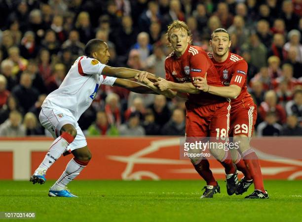Alberto Rodriguez of Braga tries to stop progress of Andy Carroll and Dirk Kuyt both of Liverpool during the UEFA Europa League Round of 16 second...