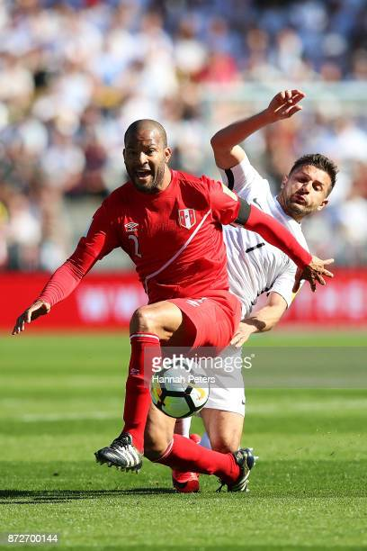 Alberto Rodriguez of Peru competes with Kosta Barbarouses of the All Whites during the 2018 FIFA World Cup Qualifier match between the New Zealand...