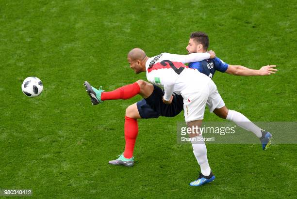 Alberto Rodriguez of Peru wins a header over Olivier Giroud of France during the 2018 FIFA World Cup Russia group C match between France and Peru at...
