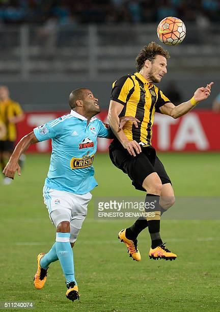 Alberto Rodriguez of Perus Sporting Cristal vies for the ball with Diego Forlan of Uruguay's Penarol during their first round Copa Libertadores...