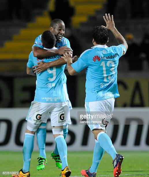 Alberto Rodriguez, Santiago Silva and Renzo Revoredo of Sporting Cristal celebrate their team's second goal during a match between Penarol and...