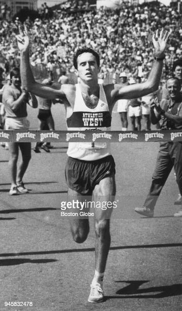 Alberto Salazar raises his arms in victory as he crosses the finish line to win the Falmouth Road Race in Falmouth MA on Aug 15 1982