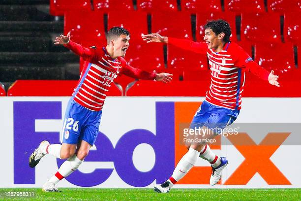 Alberto Soro of Granada celebrates with his team mate Jesús Vallejo after scoring his team's second goal during the UEFA Europa League Group E stage...