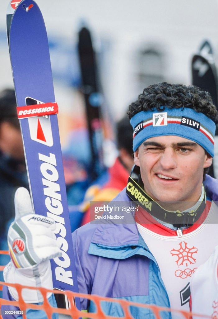 Alberto Tomba #1 of Italy celebrates his gold medal performance in the Giant Slalom event of the Alpine Skiing Competition of the Winter Olympic Games on February 25, 1988 at the Nakiska ski area near Calgary, Canada.