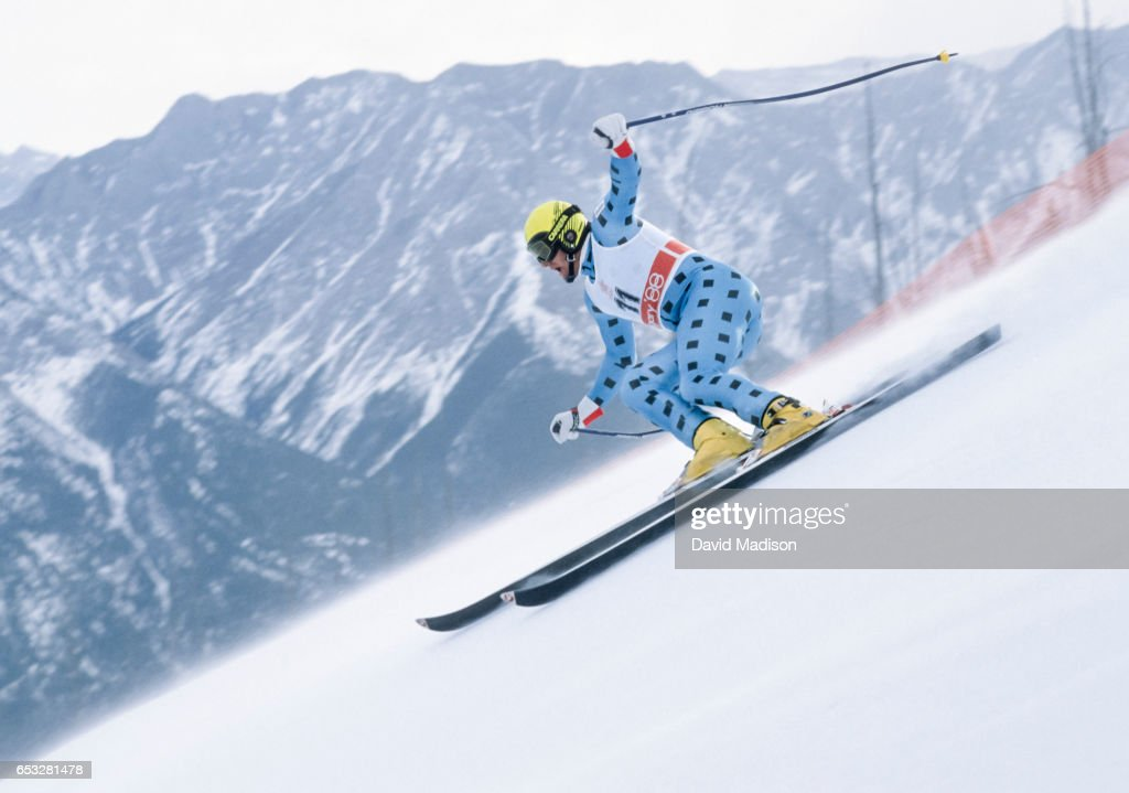 Alberto Tomba #11 of Italy skis in the Super-G event of the Alpine Skiing Competition of the Winter Olympic Games on February 21, 1988 at the Nakiska ski area near Calgary, Canada.