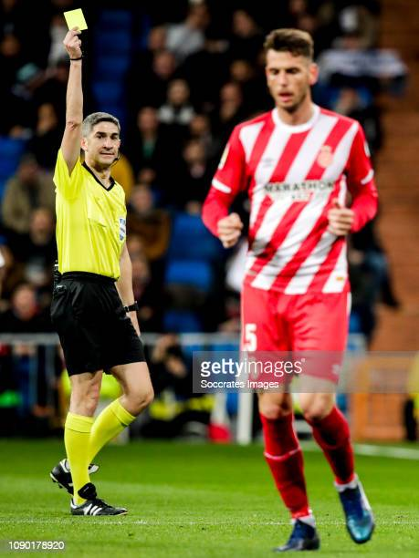 Alberto Undiano Mallenco referee Pedro Alcala of Girona during the Spanish Copa del Rey match between Real Madrid v Girona at the Santiago Bernabeu...