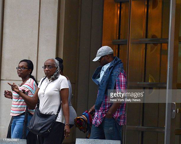 Alberto Yard a Brooklyn Civil Court Officer walks out of Brooklyn Federal Court with his family after being arrested on child porn charges on July 2...