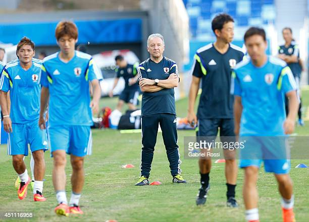 Alberto Zaccheroni coach of Japan watches his players as they practice during a Japan training session at Arena Pantanal on June 23, 2014 in Cuiaba,...