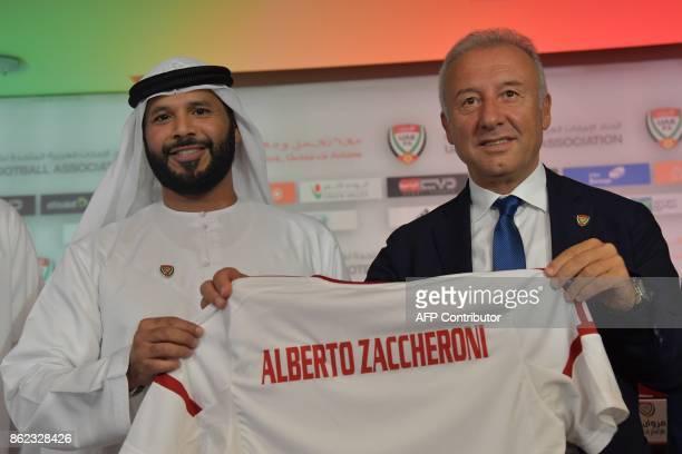 Alberto Zaccheroni the new Italian coach of the United Arab Emirates' national team poses with the President of UAE Football Association Marwan bin...