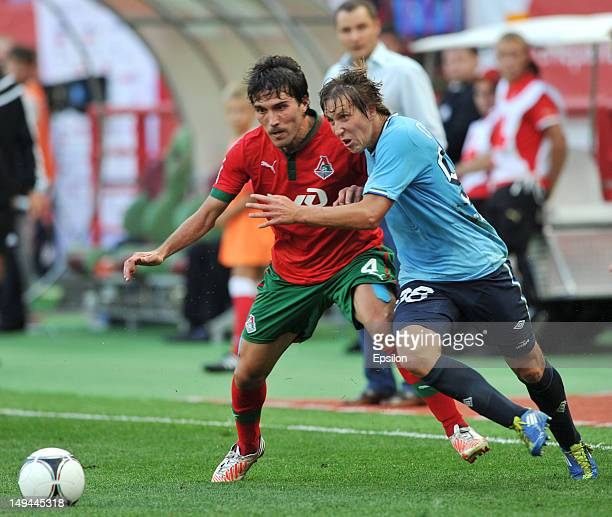 Alberto Zapater of FC Lokomotiv Moscow battles for the ball with Sergei Petrov of FC Krylia Sovetov Samara during the Russian Premier League match...
