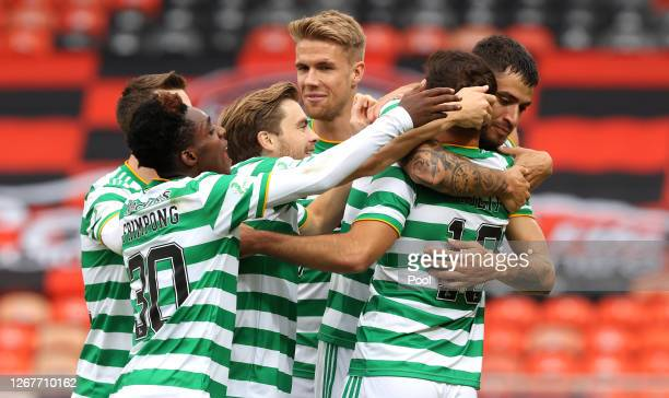Albian Ajeti of Celtic celebrates with teammates after scoring his team's first goal during the Ladbrokes Scottish Premiership match between Dundee...