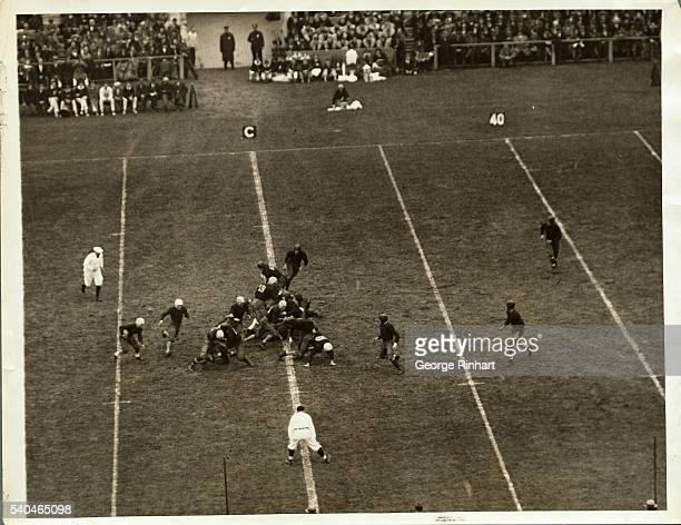Albie Booth of Yale making a vain run of 6 yards in the second quarter of the annual HarvardYale game
