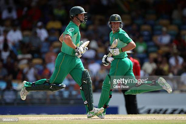 Albie Morkel and AB de Villiers of South Africa run between the wickets during The ICC World Twenty20 Super Eight match between South Africa and New...
