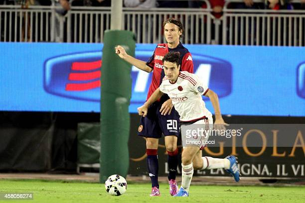 Albin Ekdal of Cagliari battles for the ball with Giacomo Bonaventura of Milan during the Serie A match between Cagliari Calcio and AC Milan at...