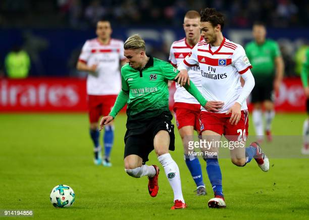 Albin Ekdal of Hamburg and Felix Klaus of Hannover battle for the ball during the Bundesliga match between Hamburger SV and Hannover 96 at...