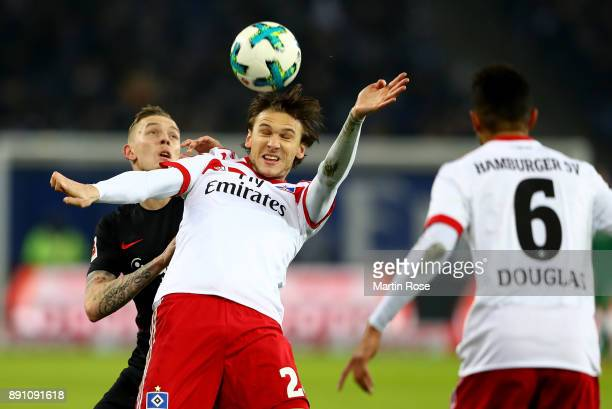 Albin Ekdal of Hamburg and Marius Wolf of Frankfurt battle for the during the Bundesliga match between Hamburger SV and Eintracht Frankfurt at...
