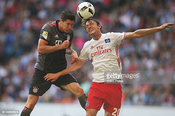 Albin Ekdal of Hamburg and Robert Lewandowski of Muenchen compete for the ball during the Bundesliga match between Hamburger SV and Bayern Muenchen...