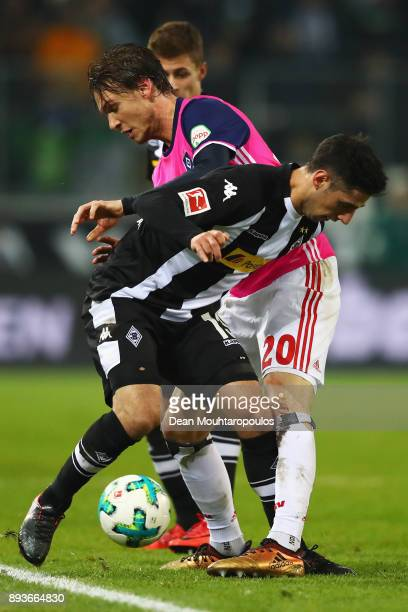 Albin Ekdal of Hamburg battles for the ball with Lars Stindl of Borussia Monchengladbach during the Bundesliga match between Borussia...