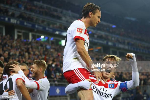 Albin Ekdal of Hamburg celebrates with Gotoku Sakai of Hamburg after JannFiete Arp of Hamburg scored a goal to make it 31 during the Bundesliga match...