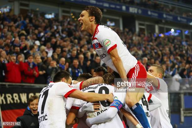 Albin Ekdal of Hamburg celebrates with other players after JannFiete Arp of Hamburg scored a goal to make it 31 during the Bundesliga match between...