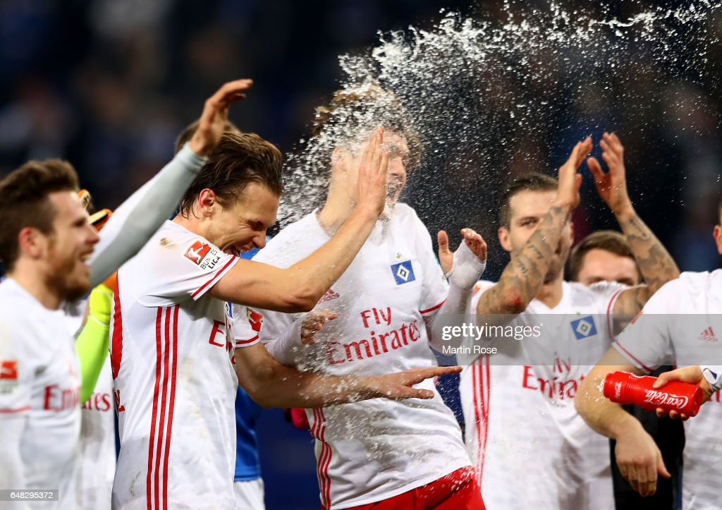 Albin Ekdal of Hamburg celebrates with team mates after winning the Bundesliga match between Hamburger SV and Hertha BSC at Volksparkstadion on March 5, 2017 in Hamburg, Germany.
