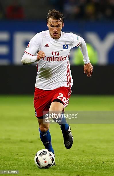 Albin Ekdal of Hamburg runs with the ball during the Bundesliga match between Hamburger SV and Borussia Dortmund at Volksparkstadion on November 5...