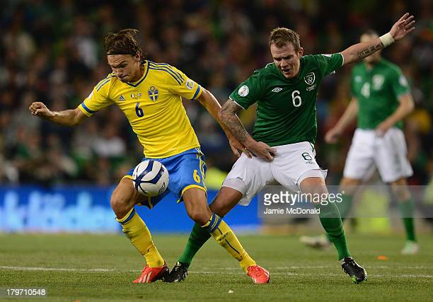 Albin Ekdal of Republic of Ireland battles with Glenn Whelan of Sweden during the FIFA 2014 World Cup Qualifying Group C match between Republic of...