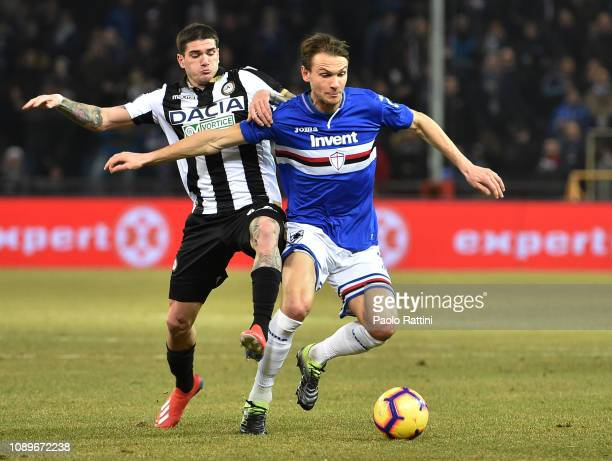 Albin Ekdal of Sampdoria competes for the ball with Rodrigo De Paul of Udinese during the Serie A match between UC Sampdoria and Udinese at Stadio...