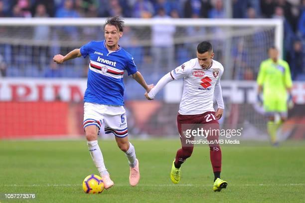 Albin Ekdal of Sampdoria competes with Alejandro Berenguer of Torino during the Serie A match between UC Sampdoria and Torino FC at Stadio Luigi...
