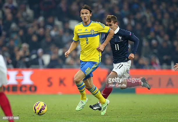 Albin Ekdal of Sweden and Antoine Griezmann of France in action during the international friendly match between France and Sweden at the Stade...