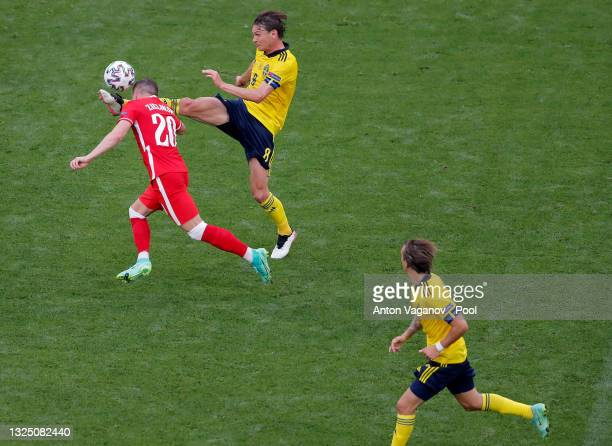 Albin Ekdal of Sweden battles for possession with Piotr Zielinski of Poland during the UEFA Euro 2020 Championship Group E match between Sweden and...
