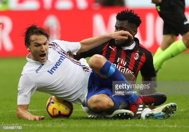 Albin Ekdal of UC Sampdoria competes for the ball with Franck Kessie of AC Milan during the Serie A match between AC Milan and UC Sampdoria at Stadio...