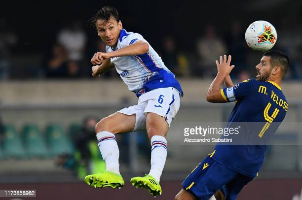 Albin Ekdal of UC Sampdoria competes for the ball with Miguel Veloso of Hellas Verona during the Serie A match between Hellas Verona and UC Sampdoria...