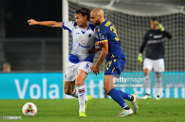 Albin Ekdal of UC Sampdoria competes for the ball with Sofyan Amrabat of Hellas Verona during the Serie A match between Hellas Verona and UC...