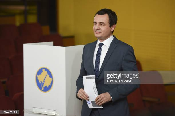 Albin Kurti prime minister candidate and leader of the main Kosovar opposition party SelfDetermination prepares to cast his ballot at a polling...
