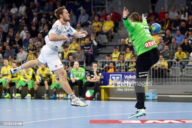 Albin Lagergren of Magdeburg tries to score against goalkeeper Andreas Palicka of RheinNeckar Loewen during the DKB HBL match between RN Loewen and...