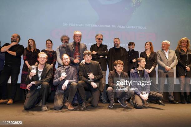 Albin Pettersson Udo Kier Olle Tholen Christoffer Nordenrot Mathieu Megemont and Park HoonJung pose with their awards and with jury members during...