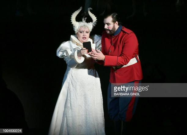 Albina Shagimuratova and Mauro Peter perform as the Queen of the night and Tamino during a dress of Wolfgang Amadeus Mozart's opera 'The magic flute'...