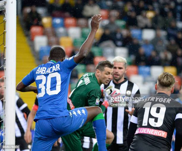 Albino Bizzari goalkeeper of Udinese competes with Khouma Babacar of sassuolo during the serie A match between Udinese Calcio and US Sassuolo at...
