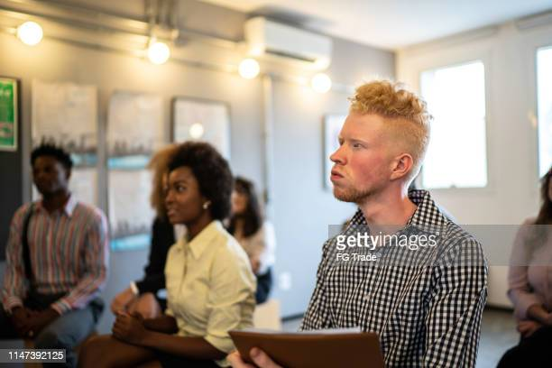 albino businessman at business conference - event - participant stock pictures, royalty-free photos & images