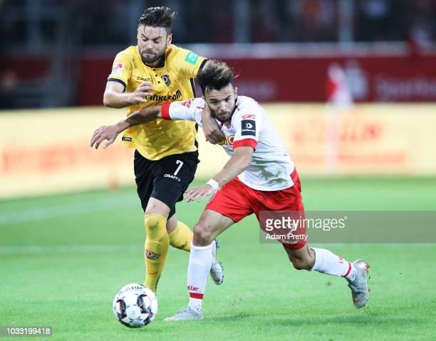 Albion Vrenezi of Jahn Regensburg challenges Niklas Kreuzer of Dynamo Dresden during the Second Bundesliga match between SSV Jahn Regensburg and SG...