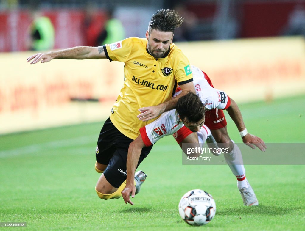 Albion Vrenezi of Jahn Regensburg challenges Niklas Kreuzer of Dynamo Dresden during the Second Bundesliga match between SSV Jahn Regensburg and SG Dynamo Dresden at Continental Arena on September 14, 2018 in Regensburg, Germany.